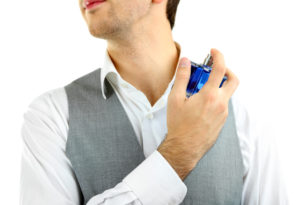 man spraying pheromone cologne