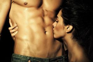 women kissing mans chest