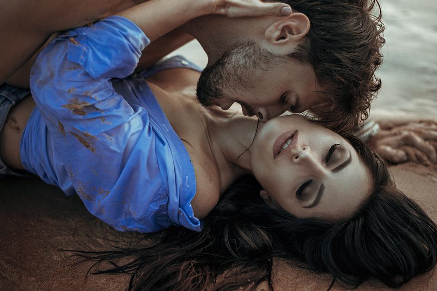 handsome man kissing beautiful women