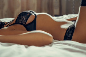 women laying on bed
