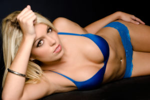Blond women in blue bathing suit with loving eyes
