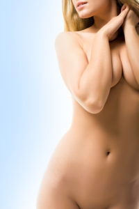 torso of naked female with genitals covered